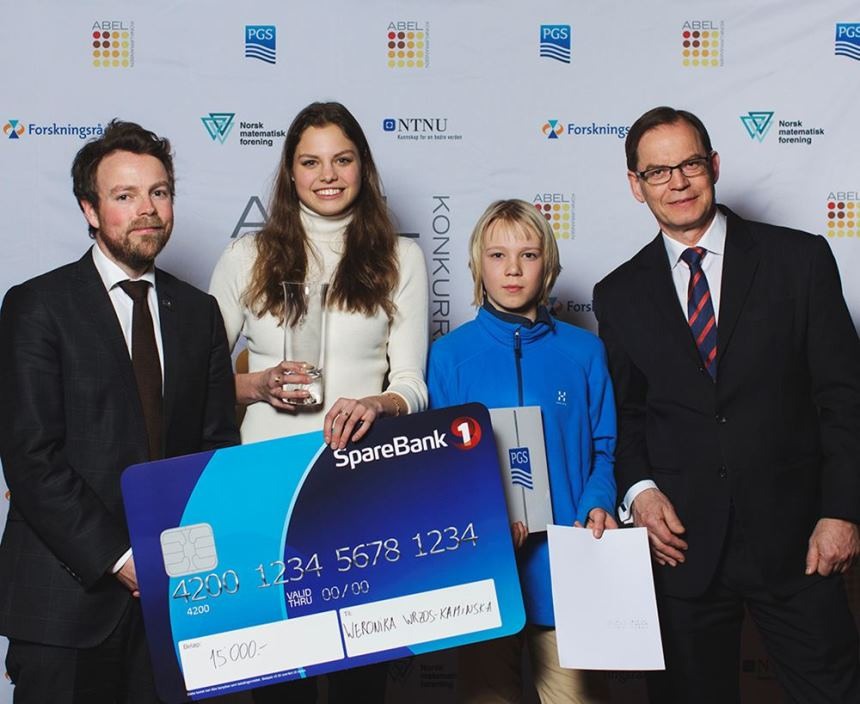 Winners Weronika Wros-Kaminska and Andreas Alberg, with Education Minister and Per Arild Reksnes EVP Operations in PGS